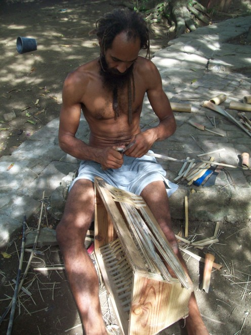 Kwao building a bamboo hive
