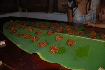 Coconut drops cooling on a banana leaf (Jamaican wax paper!)